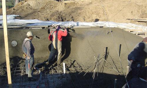 spraying concrete on steel framework